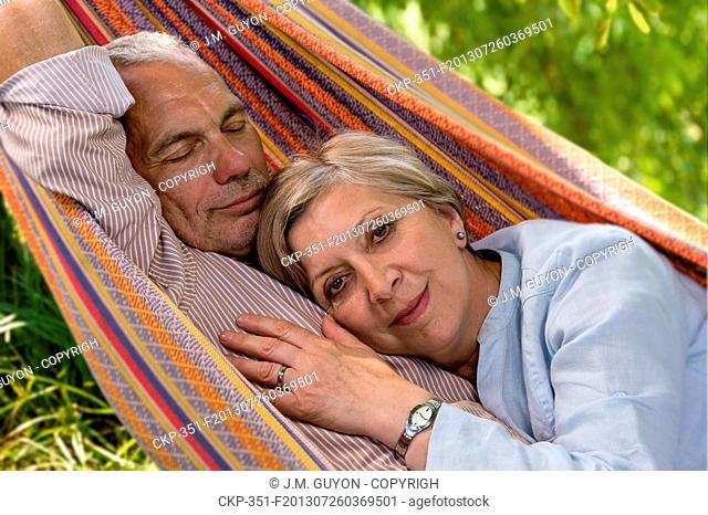 Closeup of senior Caucasian couple in hammock
