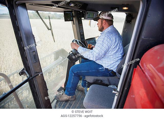 Farmer uses technology in combine for soybean harvesting; Minnesota, United States of America