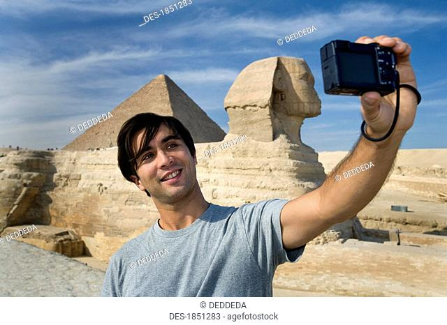 Man taking a picture of himself with Sphinx in background