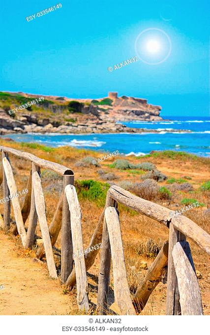 perspective view of a wooden palisade by the sea in Sardinia, Italy