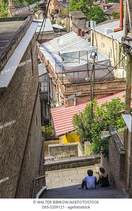 Georgia, Tbilisi, Old Town, couple on stairs, NR