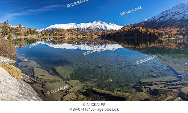 Snowy peaks reflected in lake during autumn, St Moritz, canton of Graubunden, Maloja District, Engadine, Switzerland