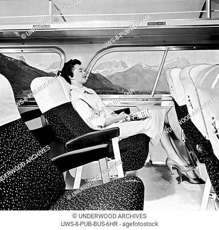 United States: 1957.A contented woman passenger on a bus relaxes as they pass through the Rocky Mountains