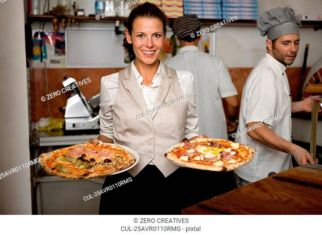 People in a pizzaria