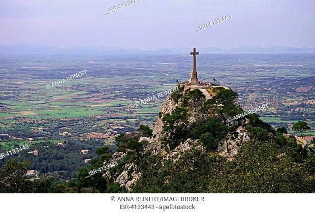 View from Puig de Sant Salvador onto Creu d'es Picot, high stone cross at the Santuari de Sant Salvador, near Felanitx, Majorca, Balearic Islands, Spain