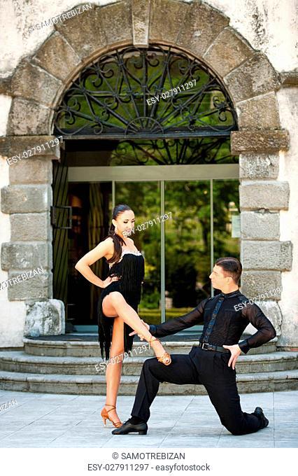 Beautiful young couple dancing outdoor
