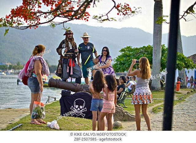 Tourists explore the colorful streets of the Historic Old District of Paraty
