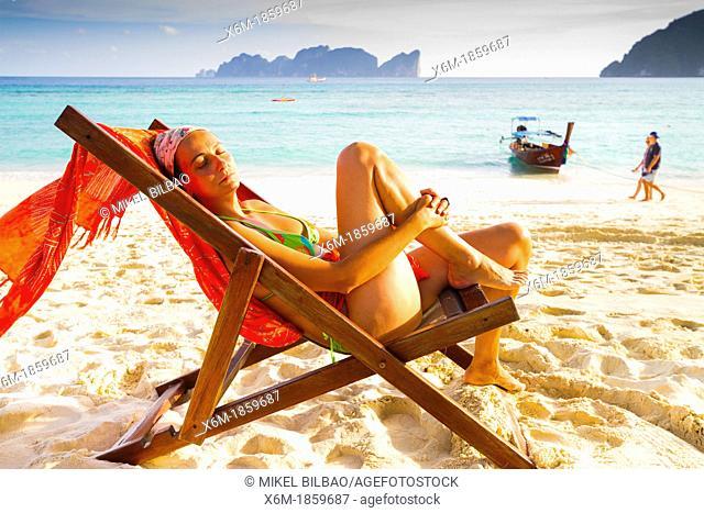 Young woman relaxing on a deckchair  Long beach  Phi Phi Don island  Krabi province, Andaman Sea, Thailand