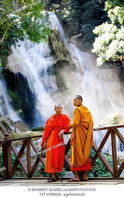 Asia. South-East Asia. Laos. Province of Luang Prabang. Monks at Kuang Si Waterfall