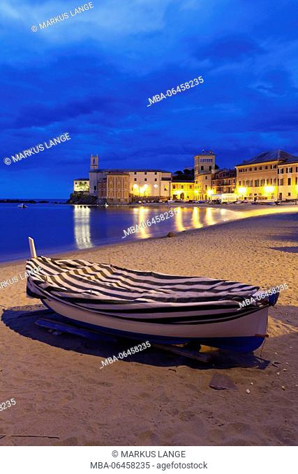 Fishing boat on the town beach in the bay Baia del Silenzio with church Chiesa di San Nicolo, Sestri the Levant, province Genoa, Rivera di Levante, Liguria