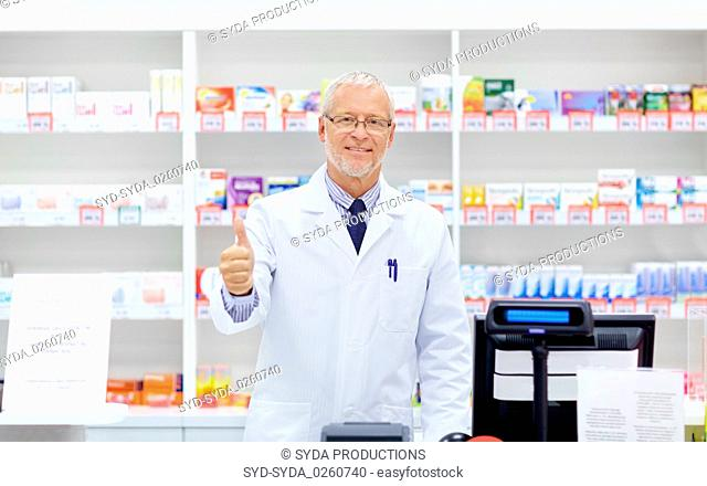 senior apothecary at pharmacy showing thumbs up