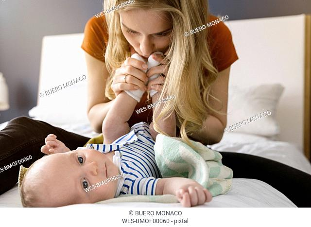 Mother kissing baby boy's feet