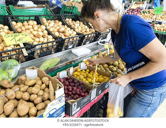Woman buying fruit in Mercado Central in Las Palmas on Gran Canaria, Canary Islands, Spain. Model released