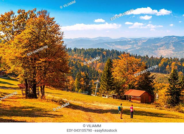 The mountainous landscape with tourists, forests in autumn colors, Slovakia, Europe
