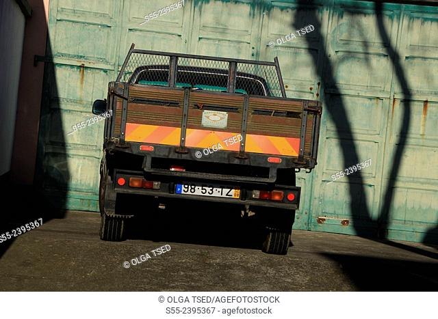 A small lorry parked by the wall. Candelaria village, Sao Miguel island, Azores, Portugal