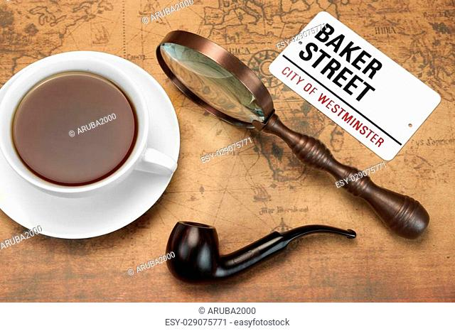 Sign BAKER STREET, Smoking Pipe, Vintage Magnifier, Full Teacup On The Old World Map. London Travel Concept. Overhead View