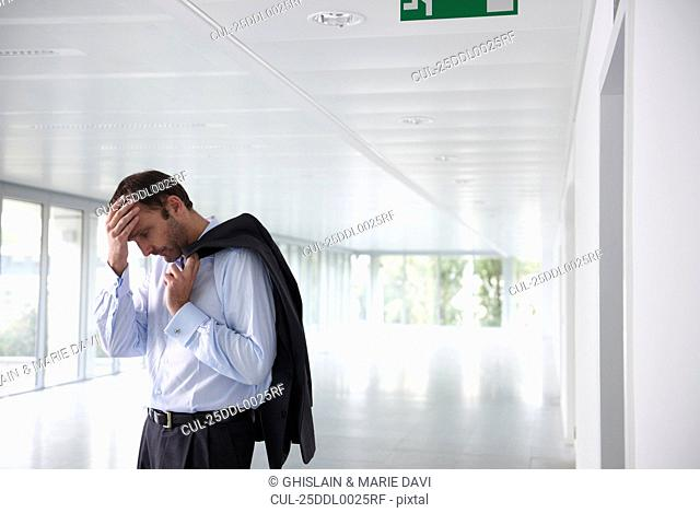 Stressed businessman in an empty office