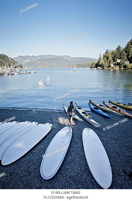 Rental paddleboards and kayaks on shore of bay;Deep cove vancouver british columbia