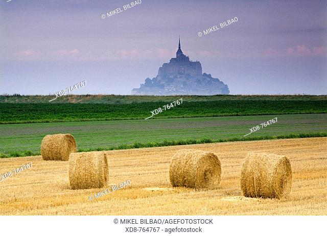 St Michael's Mount and farm land with wheat bales, Manche Department, Basse-Normandie region, Normandy, France, Europe