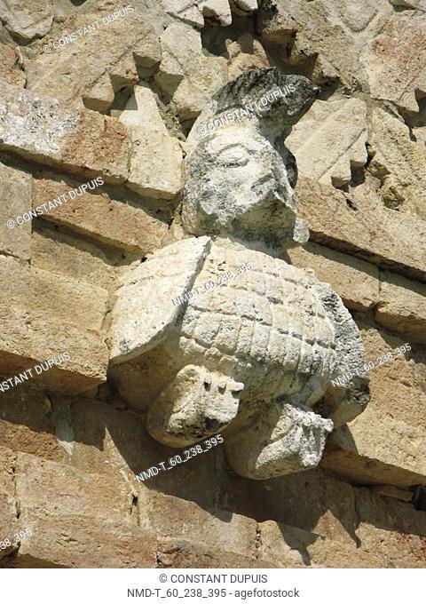 Low angle view of a sculpture on a stone wall, Nunnery Quadrangle, Uxmal, Yucatan, Mexico