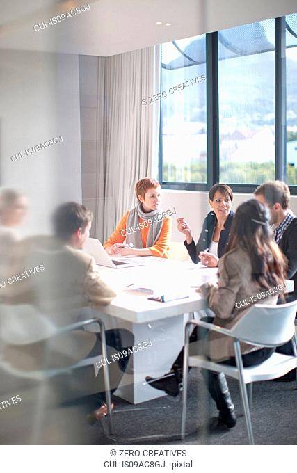 Businesspeople meeting around conference table