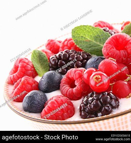 bowl of berries and yogurt