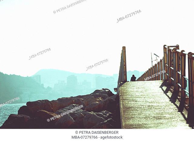 A footbridge leading over a cliff