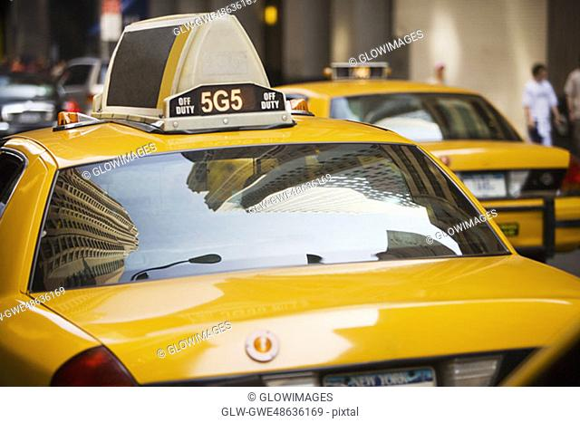 Reflection of buildings on the windshield of a yellow taxi, New York City, New York State, USA