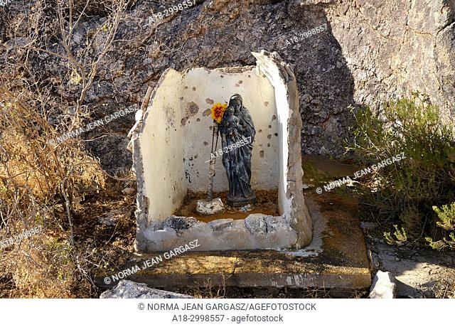 A makeshift shrine with statues of the Virgin Mary and the Christ child was erected at Mendoza Canyon, Coyote Mountains Wilderness Area, Sonoran Desert, Arizona