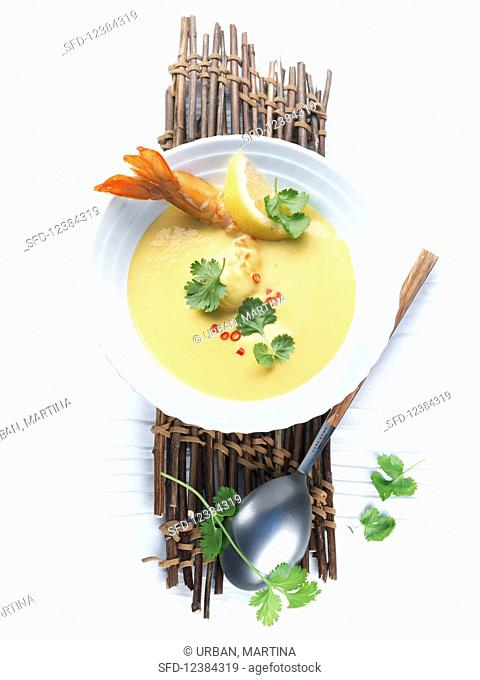 Prawn and curry soup with lemon and herbs