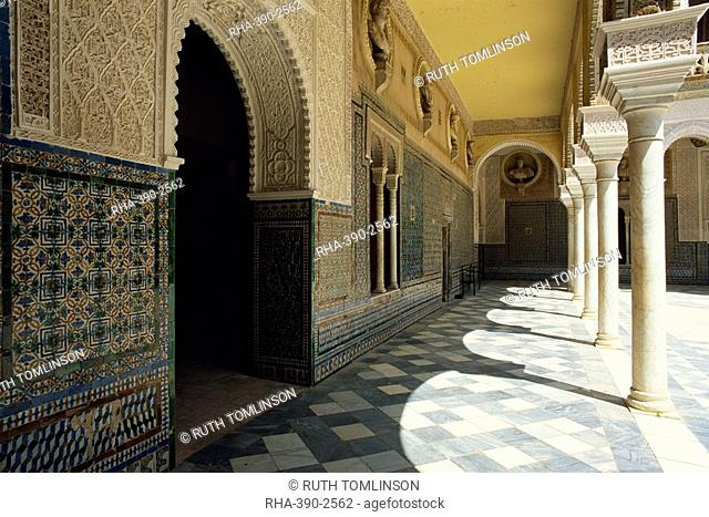 Arcade of the Patio Principal showing Mudejar carving and tilework, Casa de Pilatos, Seville, Andalucia Andalusia, Spain, Europe