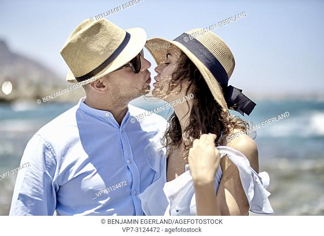 couple at beach, lovers, dating, in Hersonisssos, Crete, Greece