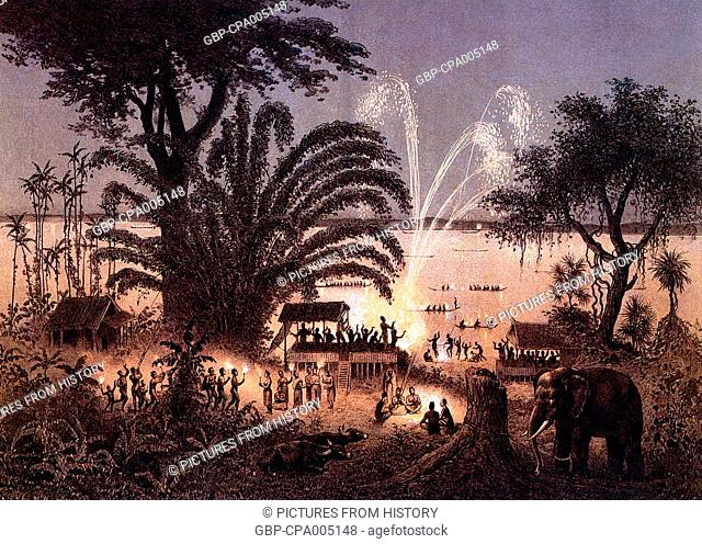 Cambodia: A festival with fireworks on the banks of the Bassac River, c 1866-68