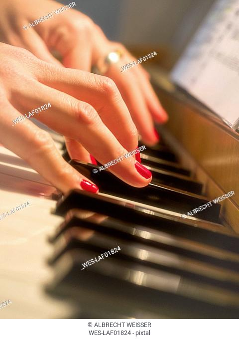 Woman's hands on piano keyboard