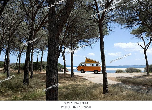 Italy, Sardinia, Posada, man on vacation with an old van