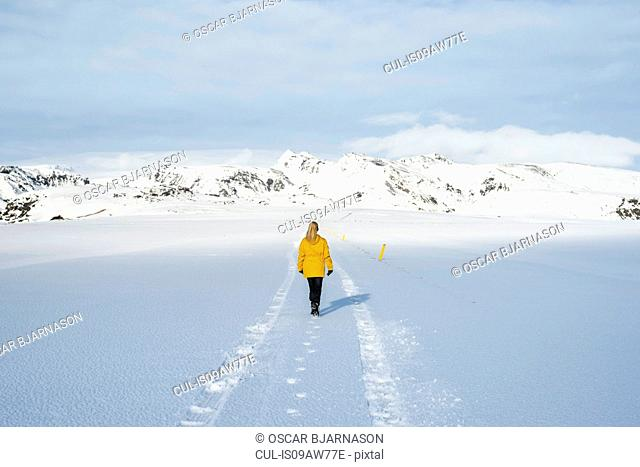Woman enjoying snow-covered field, Litla-heidi, Iceland