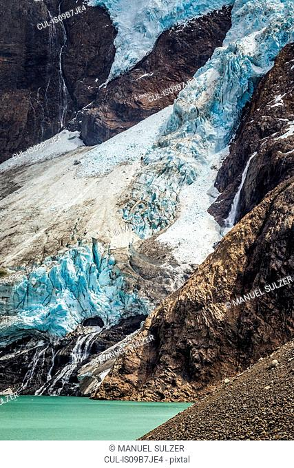 Detail of lake and glacial ice on rocky mountainside in Los Glaciares National Park, Patagonia, Argentina