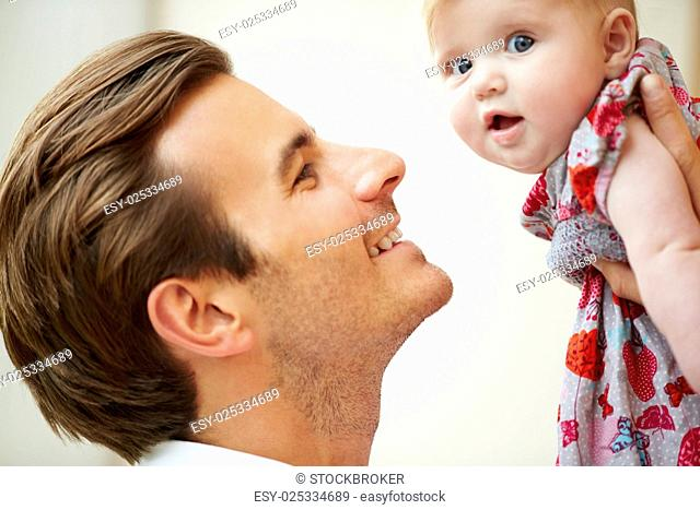 Close Up Of Father Holding Baby Daughter