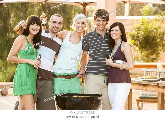 Friends having barbecue outdoors