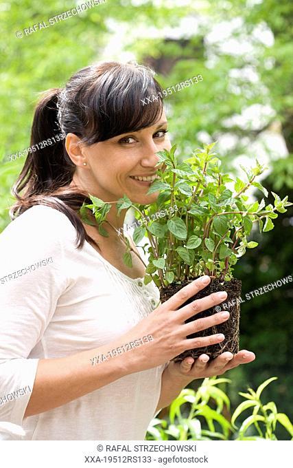 Woman smelling fresh mint