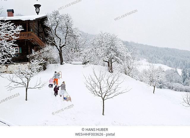 Austria, Salzburg, Hüttau, Family walking in the snow