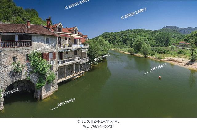 Skadar lake, Montenegro - 07. 15. 2018. Panoramic view of the Old Bridge over Crnojevica river, Rijeka Crnojevica, and the tourist area near the bridge