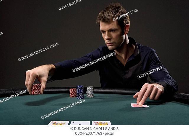 Man playing poker in casino