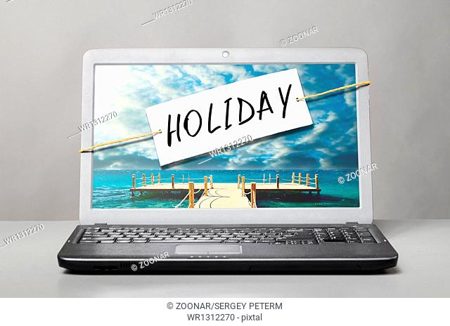 laptop with holiday note