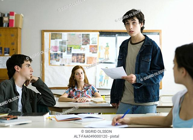 High school student giving presentation in class