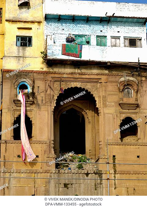 Sari drying in one of balconies of houses on ghat of holy Ganga river ; Varanasi ; Uttar Pradesh ; India