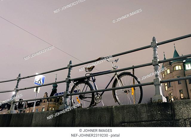 Bicycle parked at railing