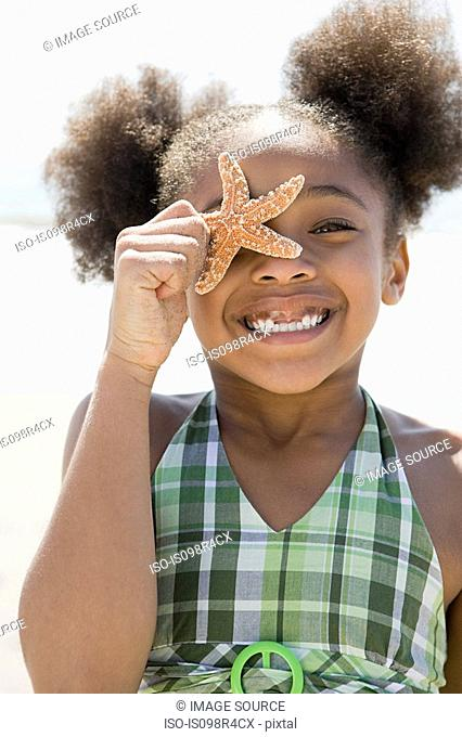 Girl holding a starfish