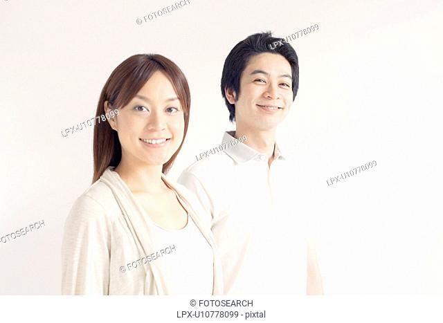 Young couple looking at camera and smiling