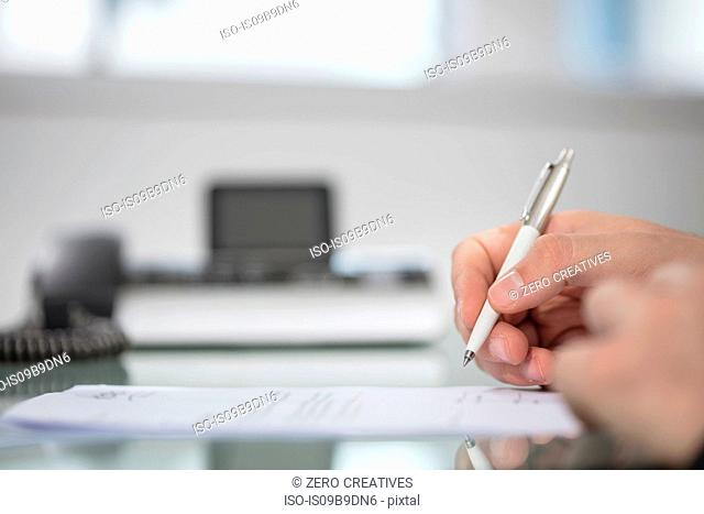 Businessman's hand signing contract